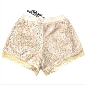 Motel Lola Ivory Silky Sequin Lace Hem Shorts